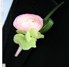 The groomsmen wore either pink ranunculus, a stem of hydrangea or a gardenia. The groom pinned a white ranunculus wrapped in satin ribbon to his lapel.