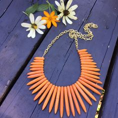 A personal favorite from my Etsy shop https://www.etsy.com/listing/278971150/orange-and-gold-howlite-spike-statement