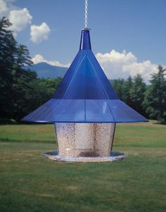 "Sapphire Sky Café - $69.95  Large capacity hopper holds 10 pounds of seed for fewer refills and the wide tray encourages birds of all sizes. Includes 24"" hanging chain. Dimensions are 17 x 17 inches.  Squirrels can't reach the seed tray & slide right off the extra large overhanging roof."
