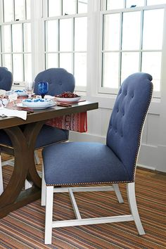"""Dining Room - 2015 Charlottesville Idea House Tour - Southernliving. Plush chairsfrom Bunny's linesurround a Georgia-madetable (tritterfeefer.com), which Bunny setwith blue-and-whiteplates inspired by herown china. """"Stickwith one color tomake collectingeasier,"""" she says."""