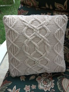 This lovely cabled pillow is both charted and written out. While it looks complicated, it could easily be your first cable project. The button flap is easy to construct and allows you to remove the cover for easy washing anytime you want. So if you have ever wanted to try cables but thought they were too complicated, take the plunge! You will be so glad you did. You can dazzle all of your friends with your brilliance.