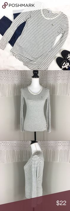 Lacoste Striped High Low Long Sleeve Tee Lacoste grey and white striped high low long sleeve tee. Size 34. US sizing 2 or extra small. Approximate measurements flat laid are 22' front length, 25' back length, 15' bust and 24' sleeve. GUC with no major flaws. ❌No trades ❌ Modeling ❌No PayPal or off Posh transactions ❤️ I 💕Bundles ❤️Reasonable Offers PLEASE ❤️ Lacoste Tops Tees - Long Sleeve