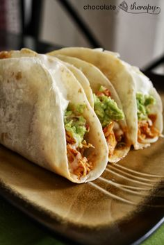 Crockpot Chicken Tacos: Dump 1 envelope of taco seasoning, 6 boneless, skinless chicken breasts a jar of salsa in the crockpot, stir and cook on high(4-6 hrs.) or low(6-8 hrs.) Should be able to shred with a fork. Place meat mixture in tortillas and top with your favorite toppings!