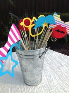 Photo booth props made from dowel rods and paper cut outs. What a great Do It Yourself project for your wedding day. It's easy, inexpensive and entertaining for your guests. #weddings #receptions #photobooth #props #bride #groom