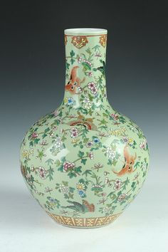 CHINESE FAMILLE ROSE PORCELAIN VASE, Qianlong underglazed blue seal mark, 19th Century. - 14 in. high. Painted to depict butterfly and floral decoration on celadon ground.