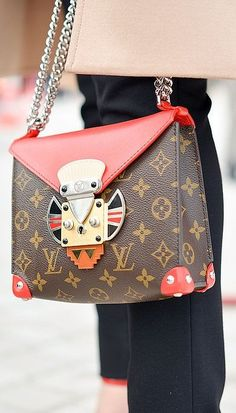 A color accented Louis Vuitton chainstrap purse at PFW.