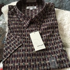 Pierre Cardin men's shirt New still in bag!  Time to buy him a surprise so he won't complain when yours arrive in the mail! pierre Cardin Tops Button Down Shirts
