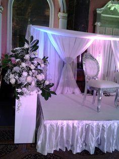 white stage pedestal arrangement