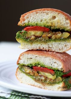 Grilled Summer Vegetable Sandwiches with Pesto - Summer in a vegan sandwich! Zucchini, summer squash, and red bell pepper doused in balsamic-thyme marinade, grilled to perfection, and then piled onto pesto-smeared artisan rolls. from @k