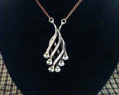 Handmade Wire Wrapped horse Shoe Nail Dangle by JudysEarthElements