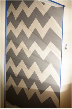 How to paint a chevron wall - good tips. This would be cute for a kids room idea or something.
