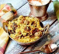 Lamb Dum Biryani! A delicious Indian meat and rice dish that traditionally took hours to make. Made in less than an hour by pressure cooking!