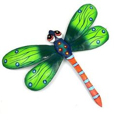 This eleven inch dragonfly is handmade in Haiti from recycled oil drums. It has a small hook to hang the piece and is painted with a bright colorful design inspired by the local Haitian culture. Meet