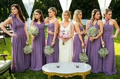 Baby's breath bridesmaids' bouquet on the purple dress. Perfect.