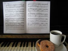 Enjoying Starbucks instant coffee, day old donuts and playing on an out of tune piano. What more can one ask for?     Classic musical instruments