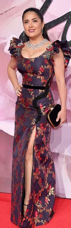 Who made Salma Hayek's blue floral gown, black clutch handbag, and gold platform pumps?
