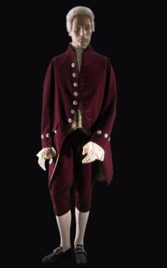SOURCE:http://www.artrenewal.IOC:Formal or Court Suit: Coat and Breeches. Wool broadcloth, cut-steel buttons, cotton lace ruffles, lined with silk and linen. By the middle of the 19th century, men's court suits followed a formula: dark wool cloth trimmed with shiny buttons, like these cut-steel examples, and embroidered waistcoats. Styled like a fashionable suit of 80 years earlier, this coat has a center-back vent and pleats trimmed with buttons at the top and peeking out from inside the…