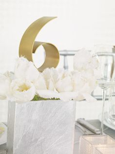 Neat and clean way to incorporate table numbers into the centerpieces...Although past 10 it might be a bit much....Unexpected Flower Ideas / The Knot / Rita Maas