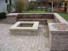 Fire Pit Designs | This fire pit and sitting bench were created with Weston Wall block by ...