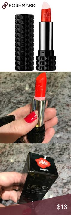 Kat Von D Studded Kiss Lipstick Countess Kat Von D Studded Kiss Lipstick in Countess. An orangey red shade. Really vibrant and beautiful! Never worn ,just swatched on my hand 💄 Kat Von D Makeup Lipstick