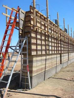 Central Arizona College - Rammed earth walls being formed and compacted