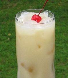 Painkiller (2 oz. Dark Rum 1 oz. Cream of Coconut 4 oz. Pineapple Juice 1 oz. Orange Juice Cherry for garnish)
