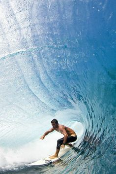 Surfing in the barrel.