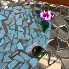 Mosaic made with tile and mirror, 3d poly flower. Details of flower and glass fused eyes 👀