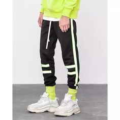 This Reflective Stripe in Fluorescent Green Trousers is perfect with hoodies and t-shirts that have a neon colour pallet so that it neutralizes the excessive details on the trouser. Our sizes may vary from other brands, be sure to checkout our Size Chart Best Mens Fashion, My Guy, Jogger Pants, Fashion Pants, Men's Fashion, Jeans Style, Street Wear, Winter Fashion, Trousers