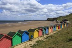 size: Photographic Print: Children Kick Football Near Colourful Beach Huts Above West Cliff Beach by Eleanor Scriven : Beach Posters, Cool Posters, North Yorkshire, Yorkshire England, Beach Huts, Tropical Art, Beach Landscape, Cliff, Seaside