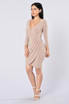 - Available in Multi and Mocha - V Neckline - 3/4 Sleeves - Tulip Hem - Made in USA - 73% Modal 27% Polyester
