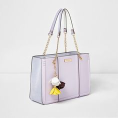 River Island Lilac purple flower charm chain tote bag ($92) ❤ liked on Polyvore featuring bags, handbags, tote bags, bags / purses, purple, shopper & tote bags, women, purple tote, tote purses and shopping bag
