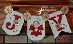 Mary created her Angel Joy Banner with the Build a Banner Kit, Gift Bow Die, and more.
