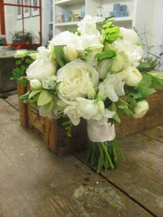 May bridal bouquet. White peonies smell amazing. And I love how the creamy white looks against the bright green.