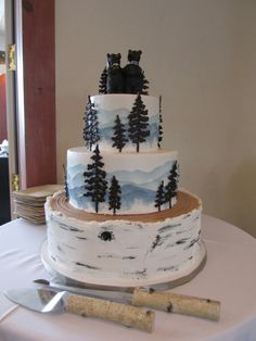 Classic Colorado wedding cake. Buttercream birch barch, and buttercream watercolor mountains behind chocolate trees. #mountainweddingcake #mountains #barkcake Www.kelleykakes.com