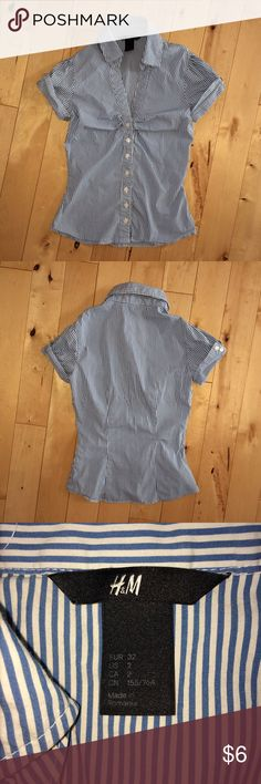 """H&M button down shirt In great condition. Just needs to be ironed. Cute cuffed sleeves with button detail. Runs small. Fits approximately a 25"""" waist, 28""""-32"""" bust, 20"""" length. Has some stretch. 74% cotton, 23% polyamide, 3% elastane. H&M Tops Button Down Shirts"""