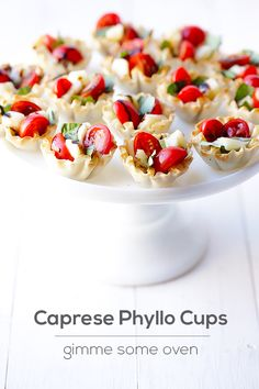 Caprese Phyllo Cups | gimmesomeoven.com   Shut.up. Greek + Italian together?! What could be better?!? Yum yum get me some.