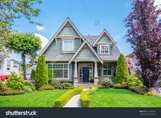 Cozy House With Beautiful Landscaping On A Sunny Day. Home Exterior. Stock Photo 251658838 : Shutterstock