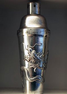 This is an antique silver cocktail shaker