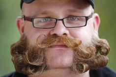 2012 European Beard and Moustache Championships - this one looks pretty normal.... minus being attacked by a curling iron.
