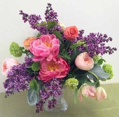 #3 - place the stems into the flower frog and create your design.  (bella fiori floral design)