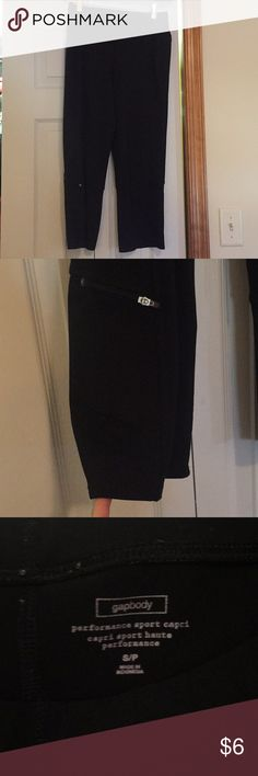 """Gapbody performance capris Black workout capris by gapbody. Polyester and spandex blend. 22"""" inseam. Small zippered pocket on bottom of right leg. Stitching is starting to come out on area on right leg as shown in picture but seam is still secure. GAP Pants Capris"""
