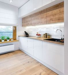 a minimalist Scandi kitchen with wooden upper cabinets, sleek white lower ones, . a minimalist Scandi kitchen with wooden upper cabinets, sleek white lower ones, a windowsill shelf Kitchen Decor, Kitchen Inspirations, Simple Kitchen Design, Home Decor Kitchen, Simple Kitchen, Scandinavian Kitchen, Simple Kitchen Cabinets, Best Kitchen Designs, Kitchen Layout