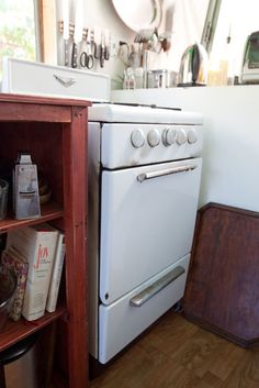 Julie's Artist In Residence Modified Airstream Trailer Gypsy Caravan (View #5) --- Sweet kitchen score! A vintage working Wedgewood stove!