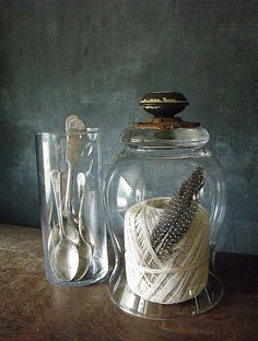 Maybe use a glass candle hurricane and add a glass plate top