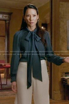 Joan's teal neck bow blouse and white wide leg pants on Elementary.  Outfit Details: https://wornontv.net/53929/ #Elementary