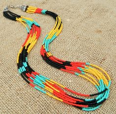 Bold Aztec inspired seed bead statement necklace. Black, red, yellow, turquoise. Entwine Art