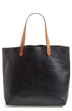 An all-purpose tote fashioned from sleek genuine leather boasts a voluminous storage compartment and sturdy straps that rest comfortably on your shoulder. This style is available in inky black or rugged brown. * Leather. * Professional leather clean. * By Madewell; imported. * Handbags.