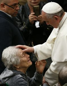 Pope Francis blesses woman during audience with people who are deaf or blind