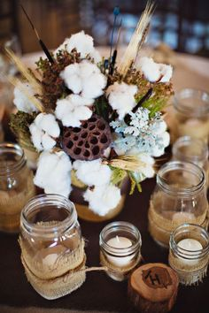 Raw cotton bouquet surrounded by burlap candles centerpiece. Rustic Centerpieces, Wedding Centerpieces, Wedding Decorations, Table Decorations, Centerpiece Ideas, Flower Decorations, Wedding Bouquets, Wedding Dresses, Fall Wedding